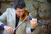 Zachary Carrettin with electric violin. Photo by Michelle Maloy Dillon.