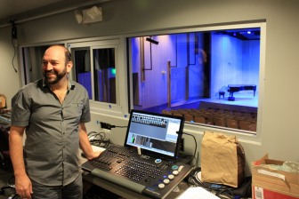Auditorium manager David Ortolano at the lighting controls of the Stewart Auditorium. Photo by Peter Alexander.