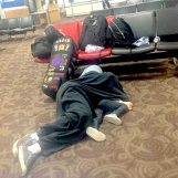 Barton Pine's husband and daughter sleeping in the Phoenix Airport. Photo via Violinist.com